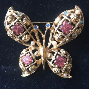 Avon Goldtone butterfly pin with 3 colored stones
